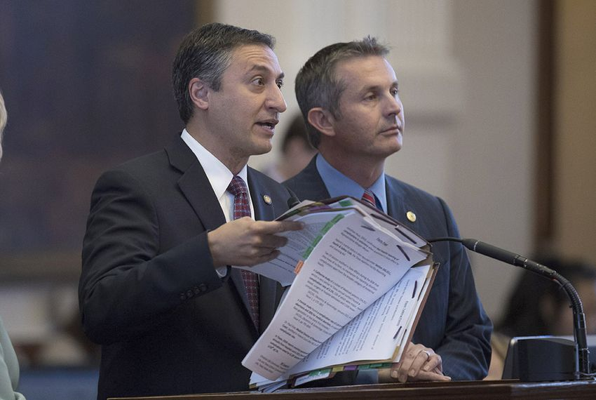 State Rep. Giovanni Capriglione, R-Southlake, debates an amendment to House Bill 13 on July 27, 2017, as Rep. Tom Oliverson, R-Cypress, looks on. The bill would refine reporting requirements for abortion providers.