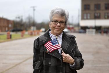 """Beth Amick of Crockett was in Navasota to honor the passing of former President George H.W. Bush. """"The Bush family is a symbol of America and they deserve all of our respect. They're a great example of America. I'm glad to here. I wouldn't have missed it,"""" said Amick. The train carrying the late president's remains passed through Navasota on Thursday afternoon."""