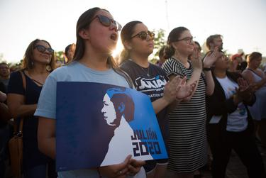 Supporters listen as presidential candidate Julián Castro speaks to at a rally in San Antonio after an earlier visit by President Donald Trump, on April 10, 2019.