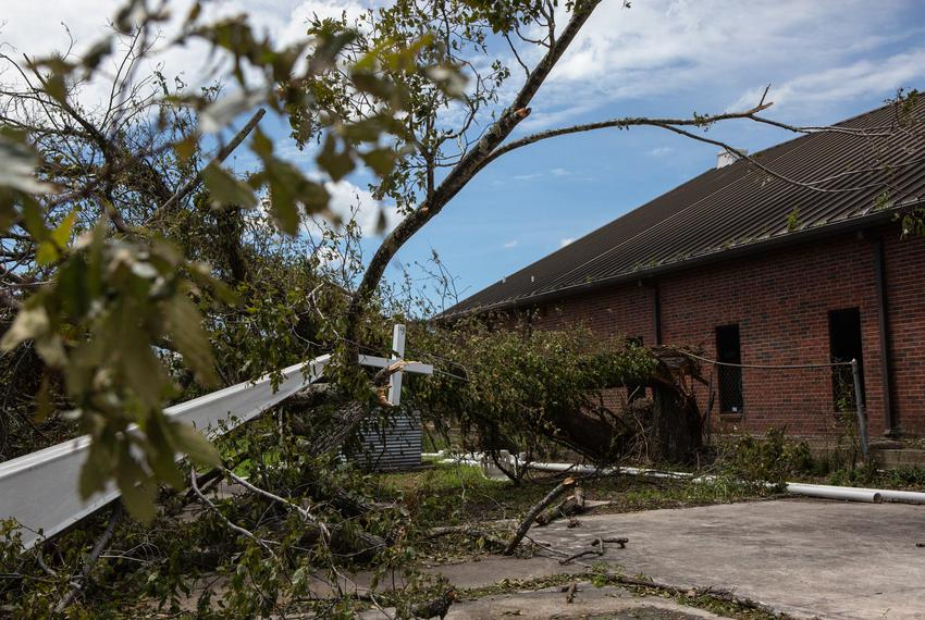 The Mount Calvary Baptist Churchís steeple lays entangled with tree debris on the ground after Hurricane Laura blew throug...
