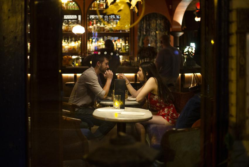 Two people dine at Ah Sing Den on East Sixth on June 9, 2021.