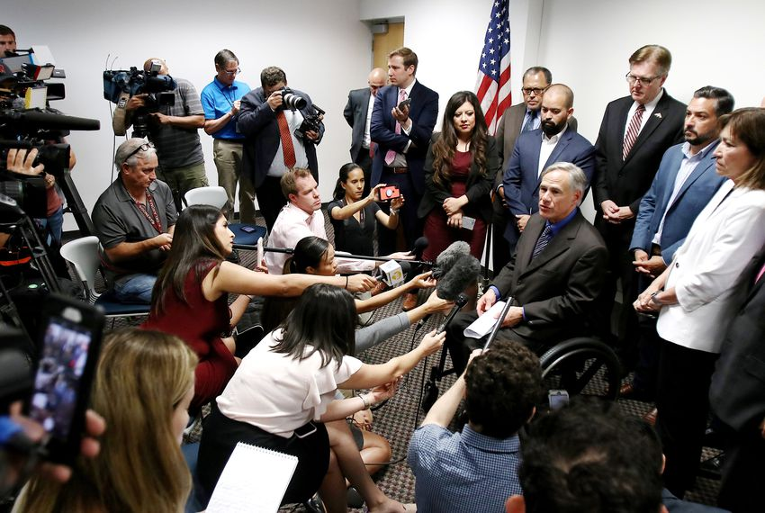 Flanked by El Paso lawmakers, Gov. Greg Abbott talks to the press after meeting with state legislators on Wednesday, August 7, 2019.