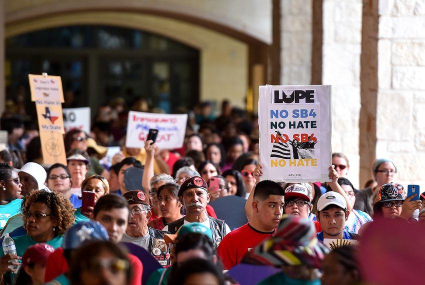 "People demonstrating against Senate Bill 4, the ""sanctuary cities"" ban, march near the Riverwalk in San Antonio on June 26, 2017."