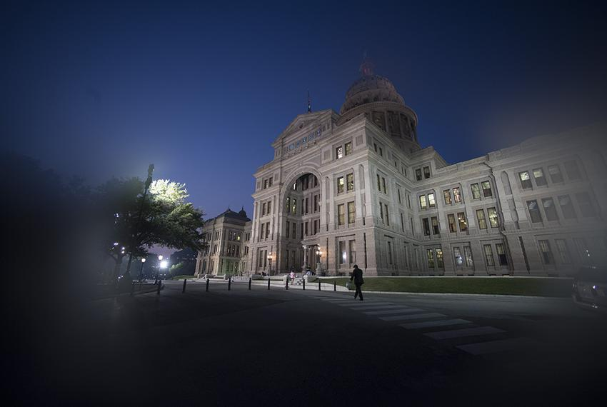 A handful of tourists hang around outside the Texas Capitol on May 11, 2017 as the House faces a midnight deadline that will…