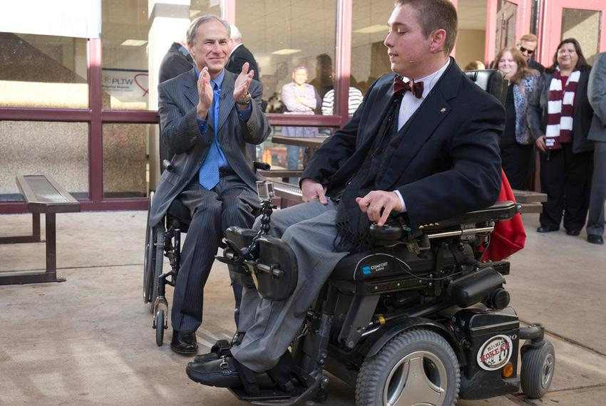 Gov.-elect Greg Abbott applauded Austin High senior Archer Hadley on Jan. 5, 2014, for raising enough money to put in auto...