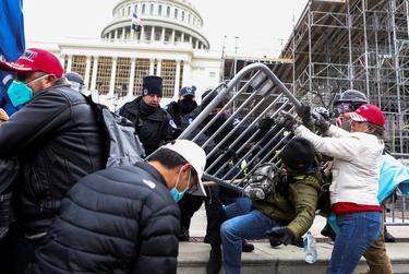 Law enforcement officers pushed back against Pro-Trump rioters attempting to enter U.S. Capitol during a protest against the certification of the 2020 U.S. presidential election results by the U.S. Congress, in Washington, D.C.