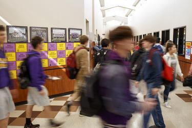 High school students between classes in the hallway at the high school in Buffalo on March 28, 2019.