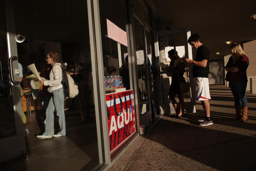 Voters wait in line to cast their ballots at a polling station in the Hancock Center on Tuesday Nov. 6, 2012 in Austin, Texa…