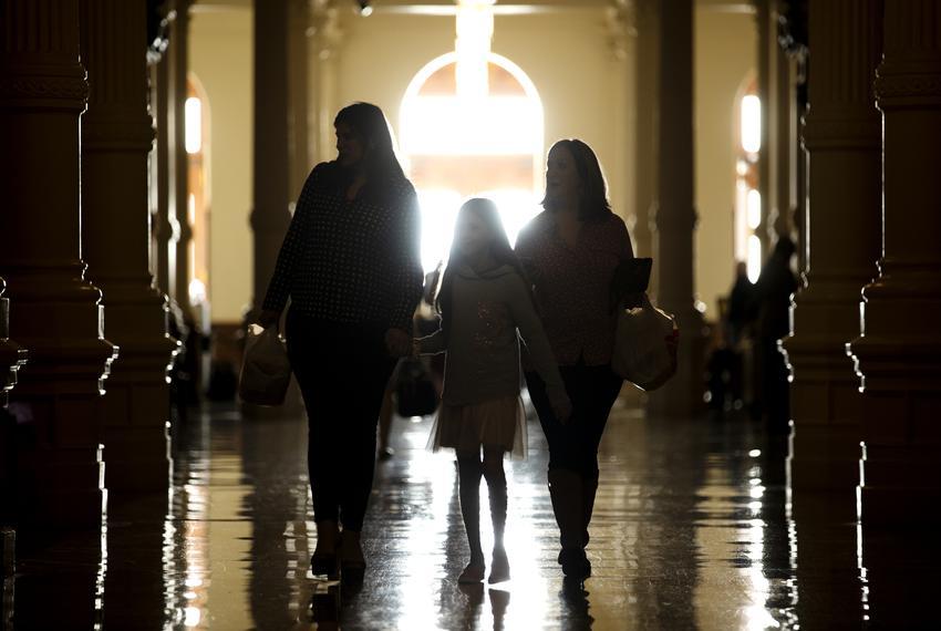 Left to right: Beatriz Ozuna, Bella Maldonado, and Klaudia Nevarez walk into the state Capitol on the first day of the 86th …