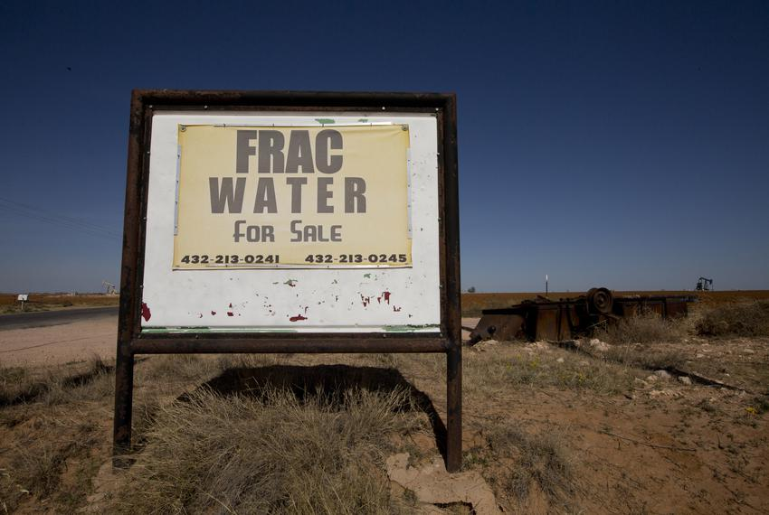 A sign on Moore School Rd. in Midland advertises frack water for sale.