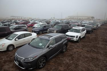 Rows of cars at the Rio Grande Valley Livestock Show Grounds. Area residents lined up early in the morning for the COVID-19 vaccine on Jan. 5, 2020.