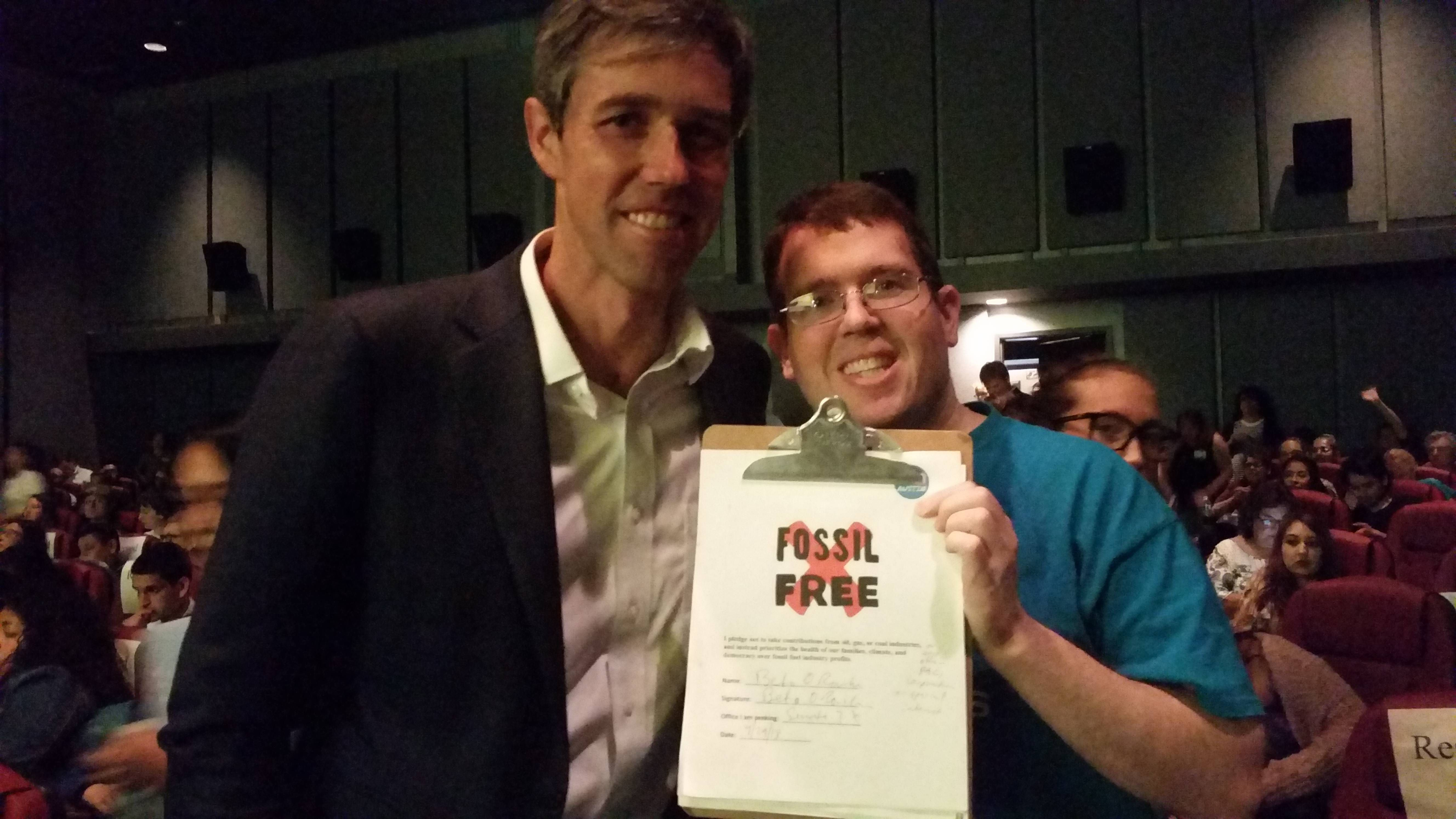 "Last April, Beto O'Rourke signed a pledge not to take campaign donations ""from oil, gas or coal industries."" Mickey Fetonte, a member of the environmental group 350 Austin, posed for this picture with O'Rourke."