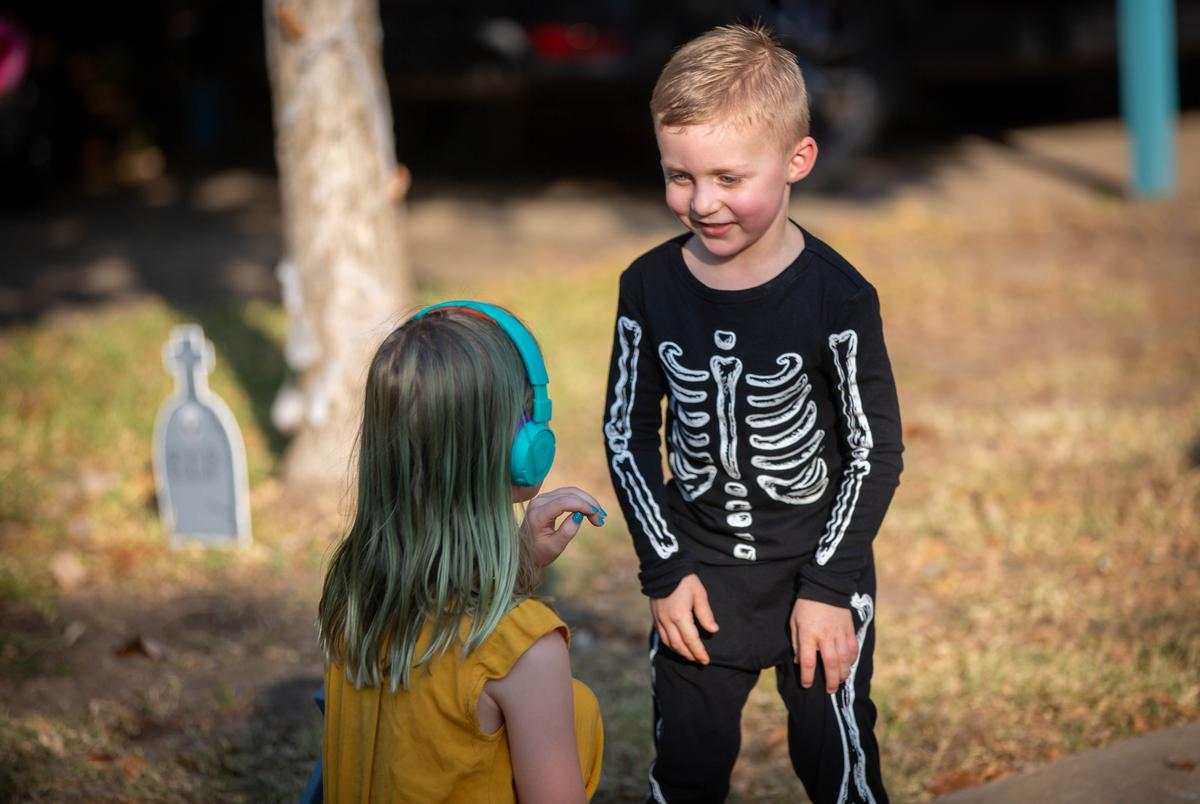 "Families across Texas are preparing for Halloween festivities during the COVID-19 pandemic. Jenn Deering Davis's family and friends have formed ""pods"" with other neighboring families to mitigate social isolation as a result of the pandemic. Oct. 19, 2020."