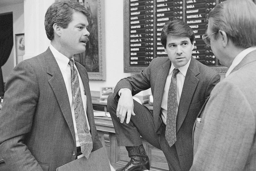 State Rep. Rick Perry is shown on April 13, 1989, on the Texas House floor with state Rep. Pete Laney (right) and Rep. Ron L…