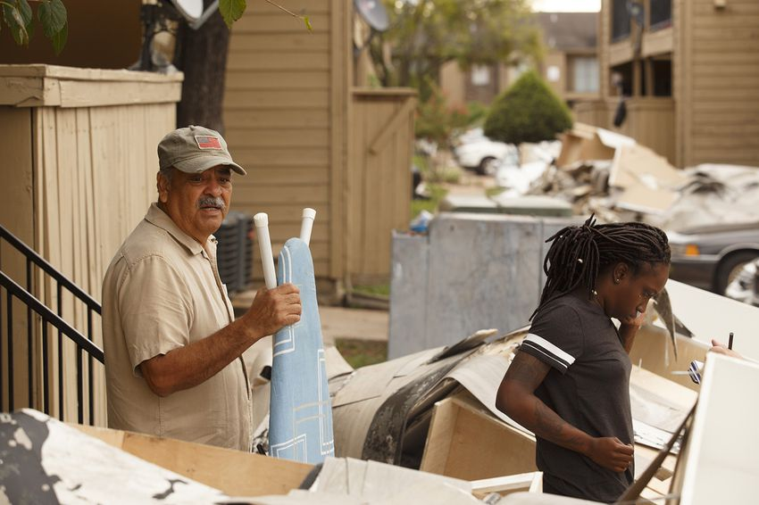 Jim Sauceda, left, with girlfriend Janel Williams, clean up after their second flooding at Collingwood Gardens apartmentcomplex near Greens Bayou in the Greenspoint area of Houston on Sept. 6, 2017.