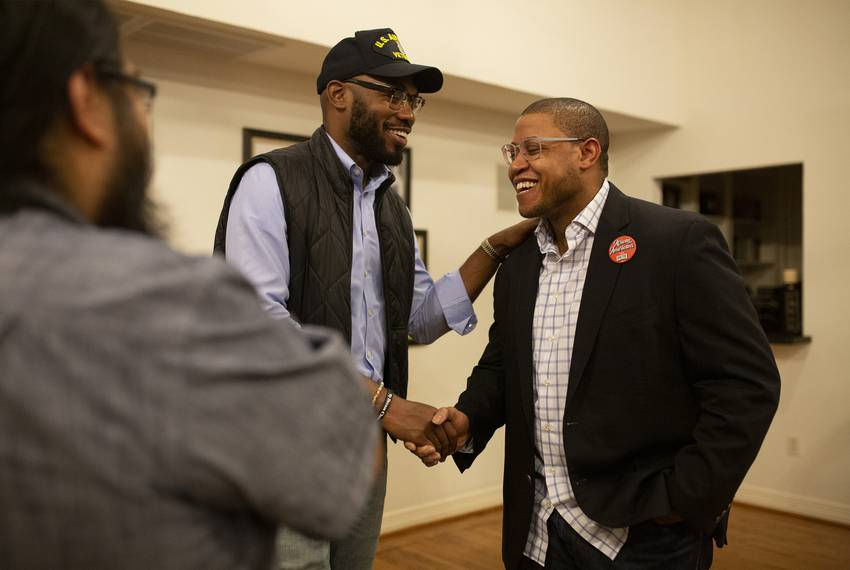 Damien Jones, left, and Canaan McCaslin, regional organizing director for Pete Buttigieg campaign, speak during the Black to Blue event in Houston on Tuesday, Feb. 18th, 2020.