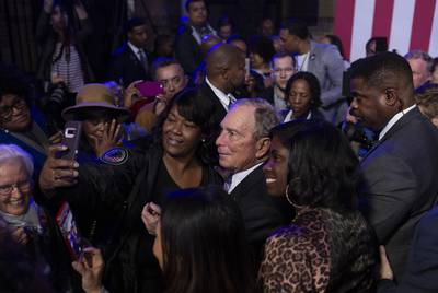 Democratic presidential  candidate Mike Bloomberg takes photos with supporters during a campaign event at the Buffalo Soldier Museum in Houston on Thursday, Feb. 13, 2020.