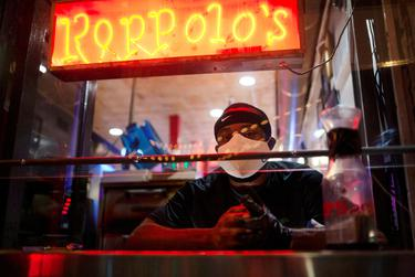 In Austin, Roppolo's Pizza manager C.J. Oyakhire waited for customers Friday, the first night Texas bars reopened after shutting down in March to help slow the spread of COVID-19.
