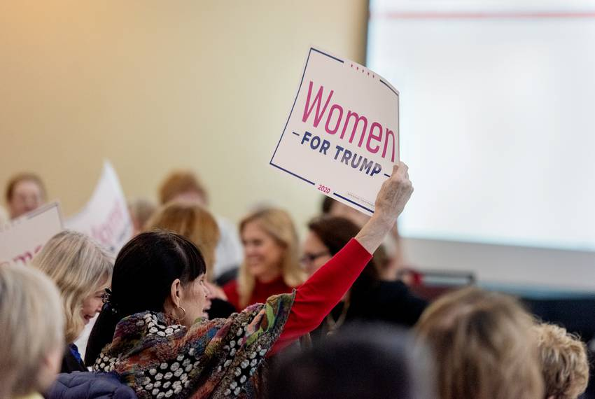 Women for Tump members cheer from their seats during the organization's holiday celebration featuring a keynote speech fro...