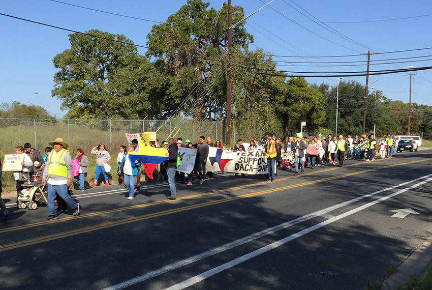 Activists nearing the end of their 37-mile march from a federal detention facility to the Texas Governor's Mansion on Nov....