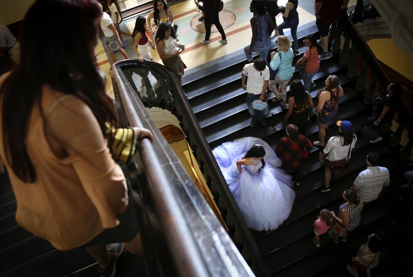 Eliana Peña wears her quinceañera dress for a photoshoot at the Texas Capitol on May 26, 2019.
