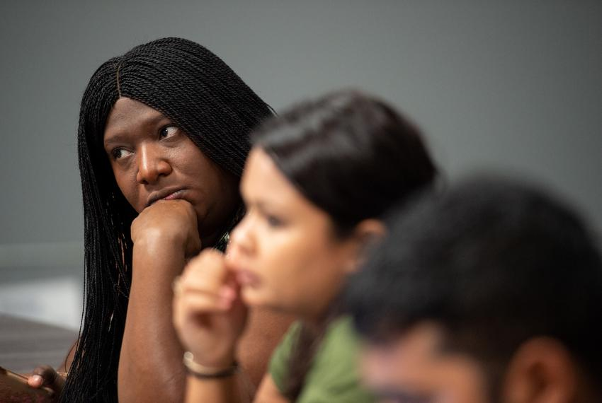 Maya Rupert, campaign manager for Julian Castro, listens during a recent planning meeting.
