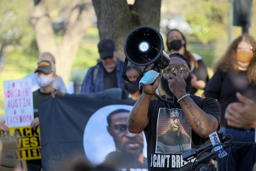 Activist and author Cluren Williams leads a chant at a rally to support the Texas George Floyd Act outside the Texas Capitol…