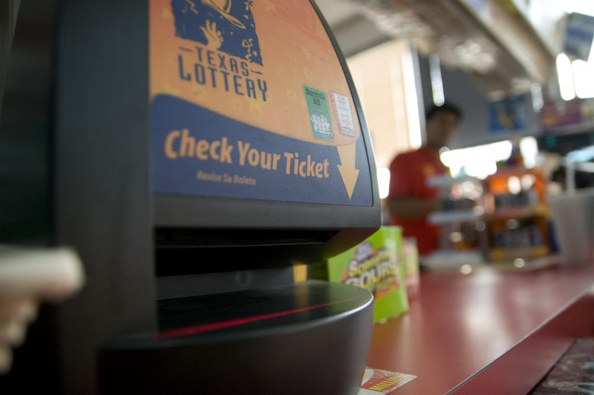 """""""Check your ticket"""" lottery machine in an Austin, TX gas station."""