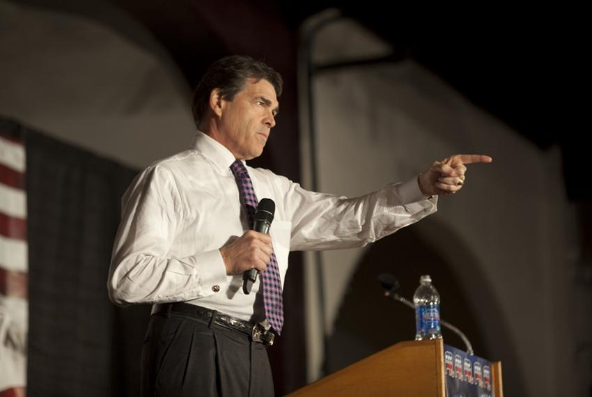 Gov. Rick Perry takes a question at the Black Hawk County Republican Party's Lincoln Day Dinner in Waterloo, Iowa, on Aug....