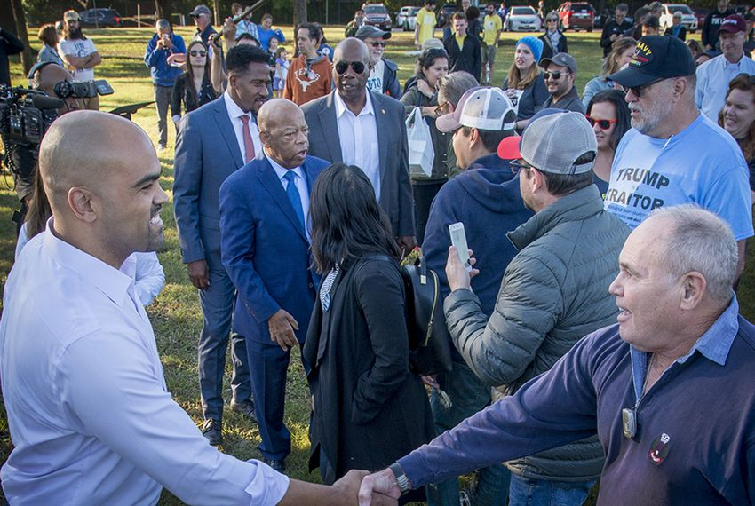 Colin Allred, left, Democratic candidate for the U.S. House of Representatives in Texas' 32nd congressional district, shakes hands with a supporter as U.S. Rep. John Lewis, D-Georgia, (blue suit and blue tie), greets well-wishers. The rally was held for candidates Allred and Texas U.S. Senate candidate Beto O'Rourke at Fretz Park in Dallas on Oct. 27, 2018.