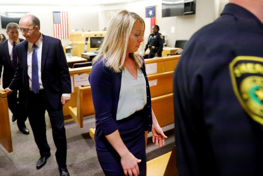 Former Dallas police officer Amber Guyger is escorted from the courtroom after she was found guilty of murder by a 12-person jury in the 204th District Court at the Frank Crowley Courts Building in Dallas on Oct. 1, 2019.