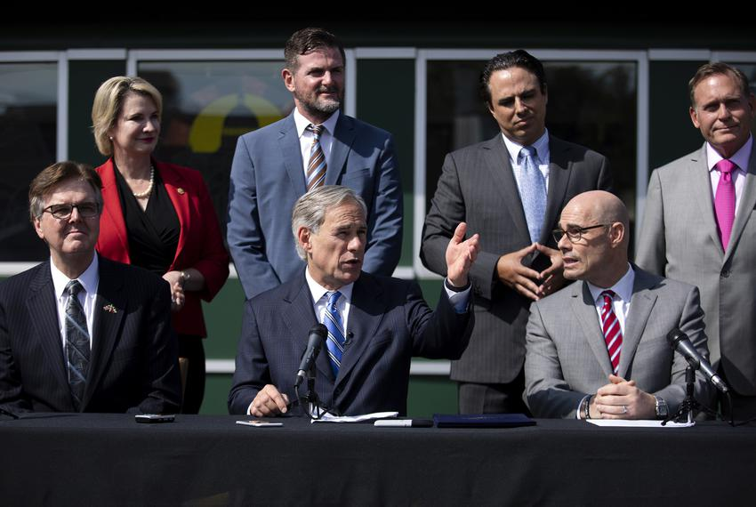 From left, Lt. Gov. Dan Patrick, Gov. Greg Abbott and House Speaker Dennis Bonnen at a press conference on Senste Bill 2. Go…