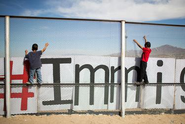 Two small boys hang on the border fence on Feb. 15, 2016, in Juarez.