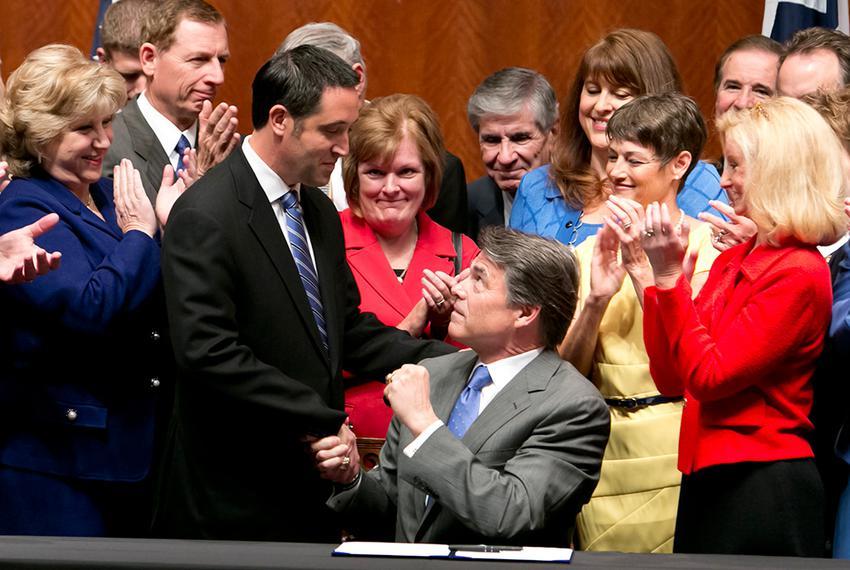Gov. Rick Perry, who signed House Bill 2 on Thursday, shakes hands with Sen. Glenn Hegar, R-Katy, the Senate sponsor of the …