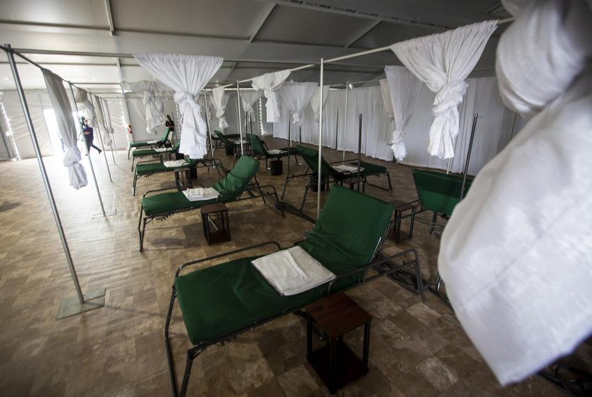 Cots are spread out along a tiled floor in one of the medical tents at NRG Park in Houston on April 11, 2020.