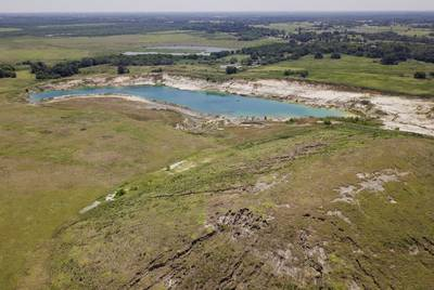 Leaving the mound of excavated dirt in place would save the company both time and money. A reclamation expert estimated it would cost as much as $4 million to remove it.