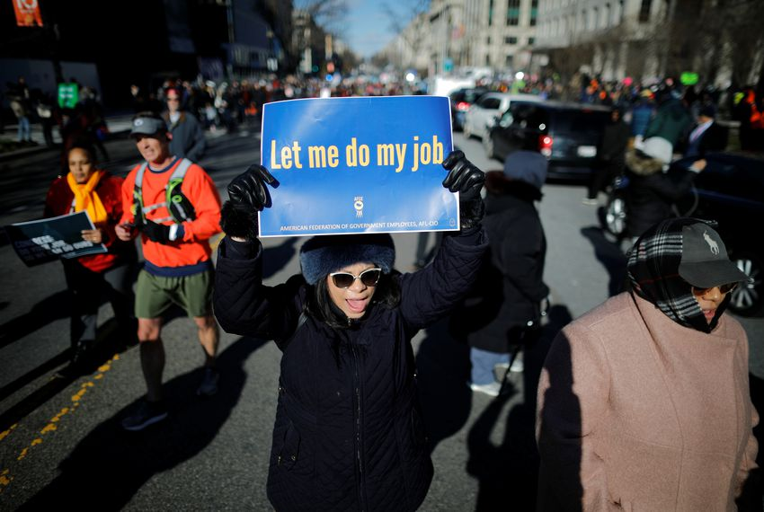 "U.S. federal government employees, contract workers and other demonstrators march during a ""Rally to End the Shutdown"" in Washington, D.C. on January 10, 2019."