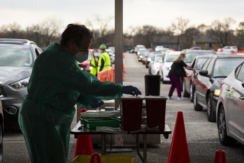 People waited for hours to receive their drive-thru COVID-19 vaccine at the Fair Park vaccination site in Dallas. Feb. 8, 20…