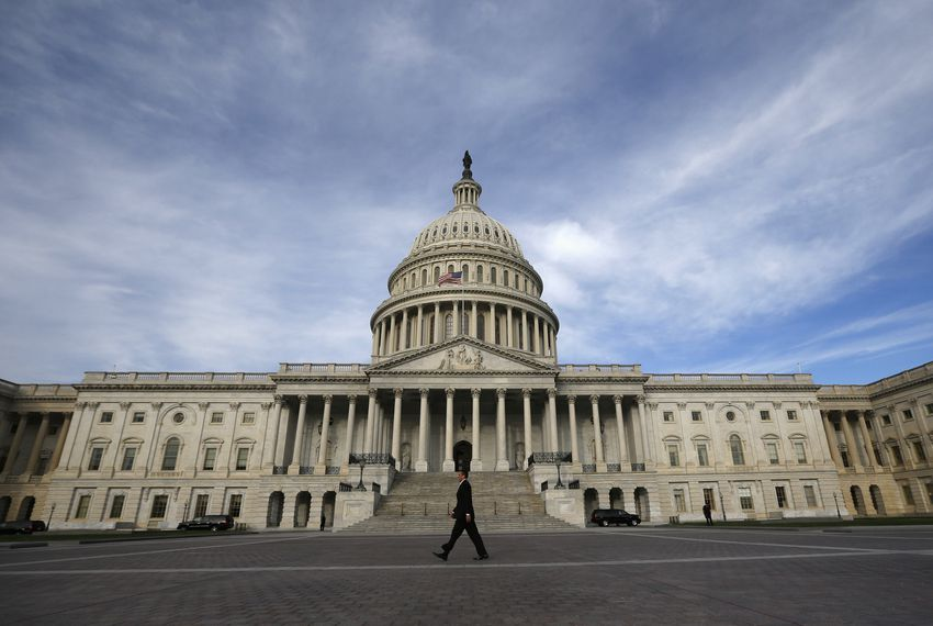 A lone worker passes by the U.S. Capitol Building in Washington on Oct. 8, 2013, during another U.S. fiscal standoff