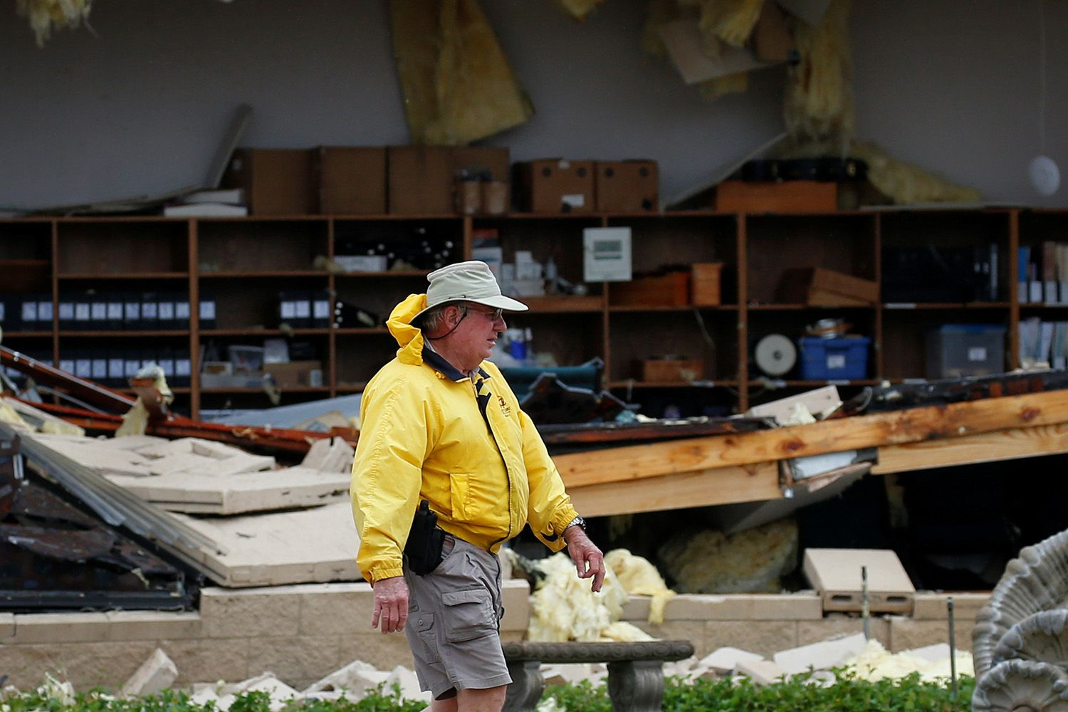 A man assesses damage to the First Baptist Church after it was hit by Hurricane Harvey in Rockport on August 26, 2017.