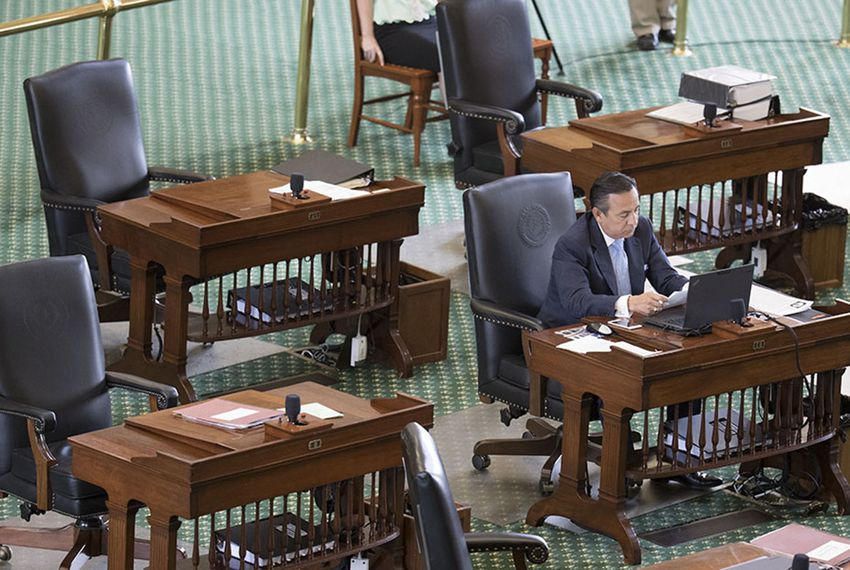 State Sen. Carlos Uresti, D-San Antonio, sits in a nearly empty Senate chamber for his Republican colleagues to return on July 24, 2017.