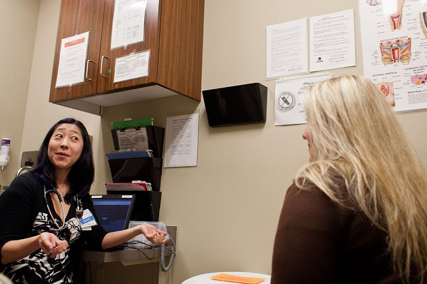 Patient Carrie Adner of Austin speaks with Dr. Krissie Yamamoto at the Seton-Circle of Care Women's Services at the Texas A&M Health Science Center.