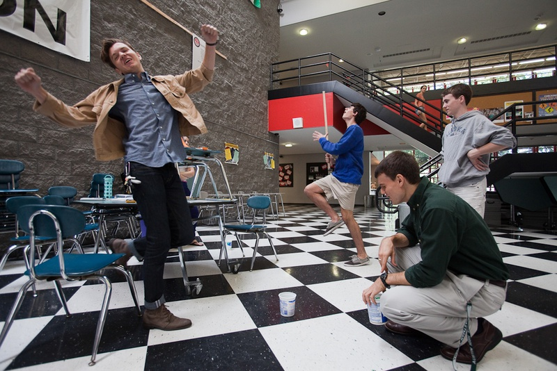 At Houston's High School for the Performing and Visual Arts, Keenan Hurley (left), 18, and Roby Attal, 17, react to missing their target during a physics lesson on projectile motion that used Hot Wheels cars.