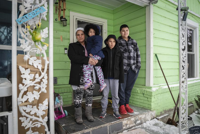 Marleny Almendarez, 38, with her niece Madelyne Hernandez, 3, and two boys, Aaron Hall, 11, and Matthew Hall, 14, outside th…