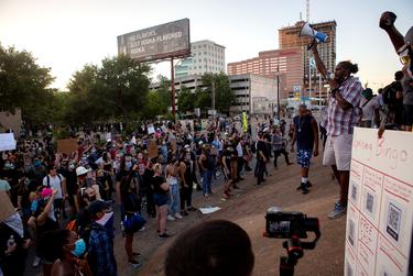 Demonstrators gather outside Austin Police headquarters for another night of protest against police violence towards people of color, in Austin on June 4, 2020.