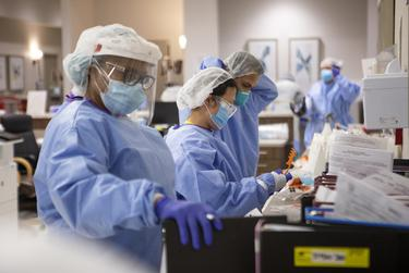 Nurses and doctors in the COVID-19 unit at Doctors Hospital at Renaissance Health System in Edinburg.