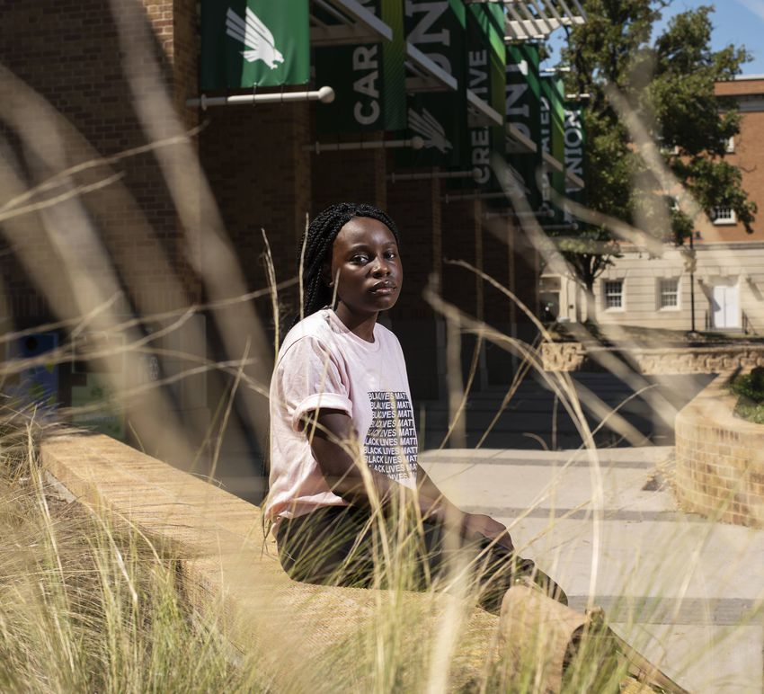 Aimee Tambwe, a sophmore, outside of the student union on the campus of the University of North Texas in Denton. Ambwe notic…