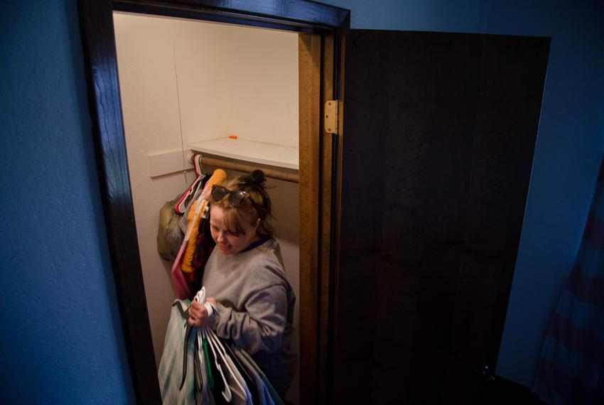 Wendy Bryant grabs the last of her clothes from the room she had been staying in at a friends place before moving to a new m…