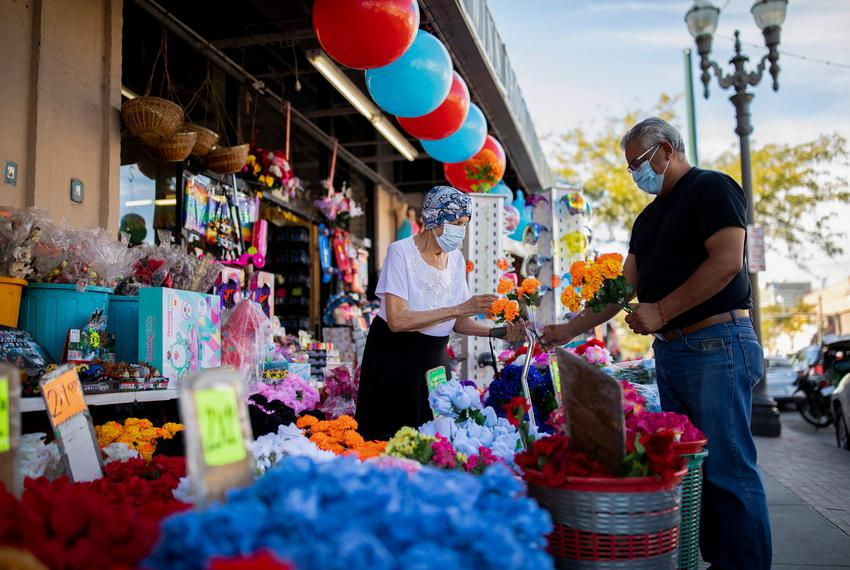 """Shoppers buy traditional flowers for the upcoming Mexican holiday, """"Día de Los Muertos,"""" near the Paso del Norte Internation…"""