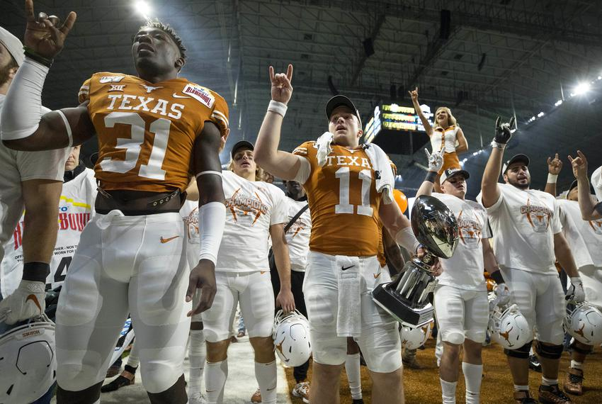 The University of Texas football team celebrates after defeating the Utah Utes at the Valero Alamo Bowl at the Alamodome in …